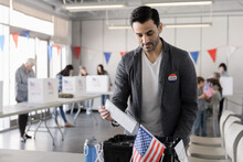 Male Voter Placing Ballot In B...