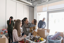 Family Donating Toys In Commun...