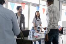 Happy Volunteers Helping Voter...