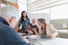 Young Woman Teaching Seniors H...