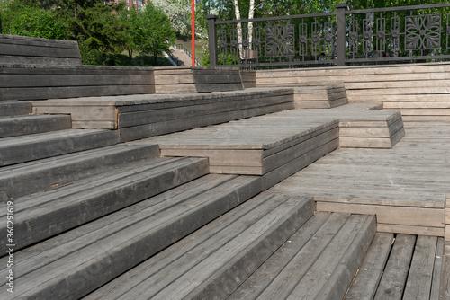 Fotografie, Obraz A multi-tiered wooden amphitheater near the riverbank.
