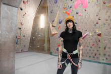 Portrait Confident Young Transgender Woman At Indoor Climbing Wall