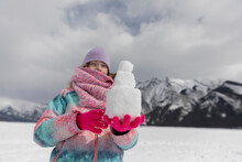 Girl Holding Pile Of Snow