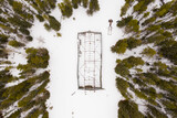 Drone shot over incomplete building in snow