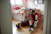 Teenage Girl Putting On Volley...