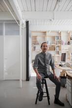 Portrait Of Senior Asian Man In Creative Office