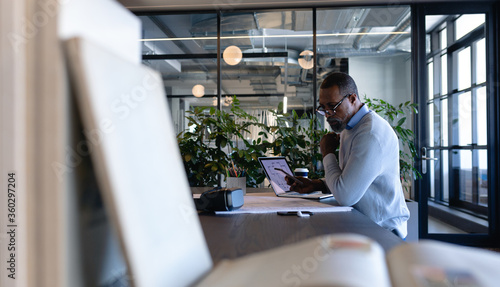 African American man working in modern office