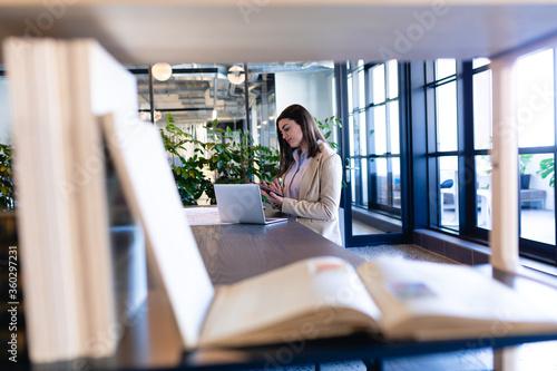 Caucasian woman working on her laptop in modern office