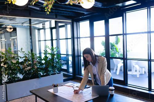 Caucasian woman working in modern office