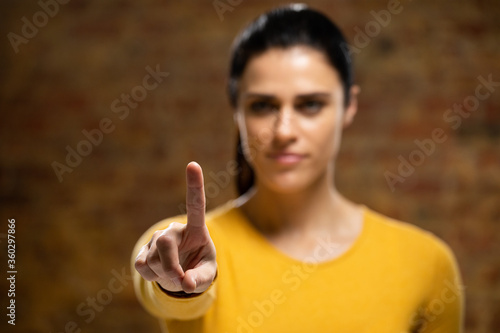 Caucasian woman with arm raised and hand