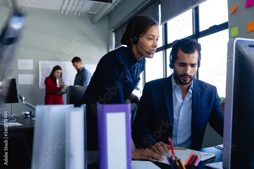 Business people working with headset phone in office