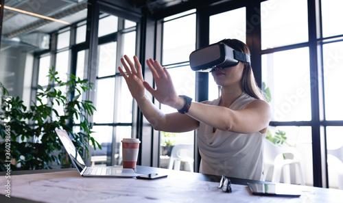 Asian woman using virtual reality at work
