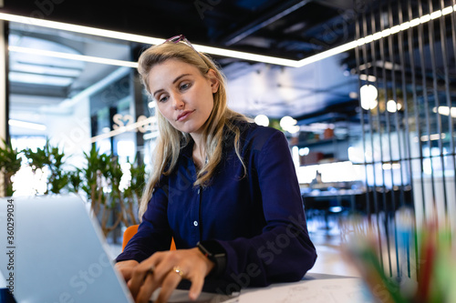 Caucasian woman working on her laptop