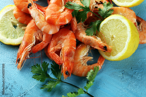Raw fresh Prawns Langostino Austral. shrimp seafood with fresh lemon and spices.