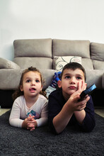 Siblings Watching A Home Movie...