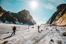 Rear View Of Explorers Crossing The Parade Glacier, Baffin Island.