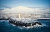 Majestic scenery of lighthouse on rocky coast