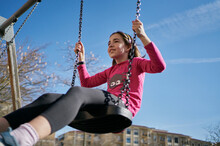 Girl On A Swing With A Blue Sk...