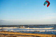 Kite On The Beach. Kitesurfing At The Sea In Windy Weather