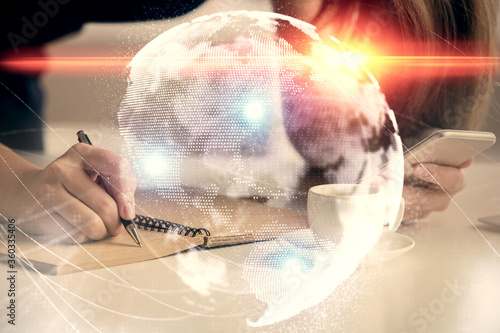 Fotomural Double exposure of business theme sketch hologram and woman holding and using a mobile device