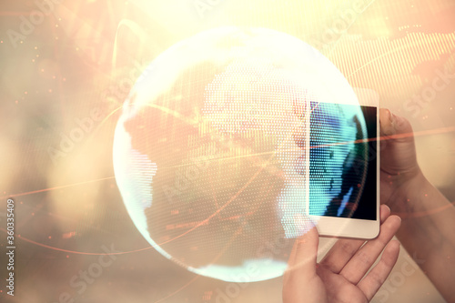 Cuadros en Lienzo Double exposure of business theme sketch hologram and woman holding and using a mobile device