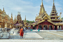 Buddhist Monk Walking Near Shw...