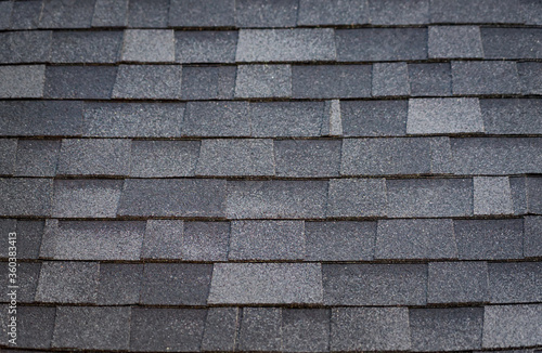 A pattern created by asphalt shingles on a roof. Canvas-taulu
