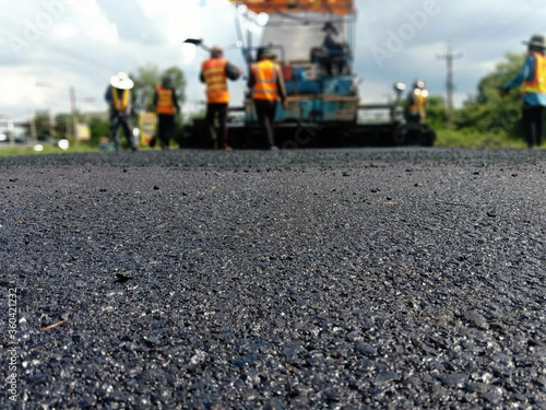 Fototapeta Blur image, asphalt paving With heavy machinery