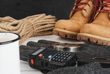 Equipment set for traveler including hiking boots and walki-talkie