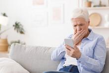 Worried Senior Lady Reading Sh...
