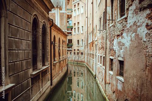 narrow street in venice italy © kirollos