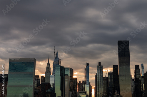 Dark and Creepy Midtown Manhattan Skyline during a Sunset with Large Ominous Clouds in New York City