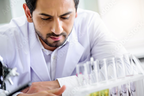 Fotografía Caucasian scientist man lab technical service observe liquid sample with lab gla