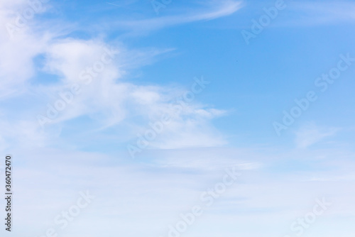 White clouds on a blue sky as background Canvas-taulu