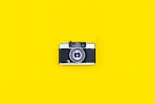 Vintage Camera On A Yellow Bac...