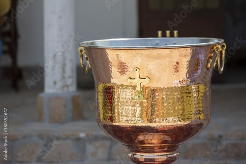 Fototapeta Close up shot of christian Greek Orthodox baptismal pool in the light of day