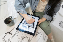 Artist Using Tablet And Stylus...