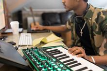 Young Man Using Keyboard In Mu...