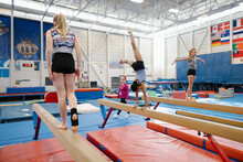 Girls On Balance Beams In Gymn...