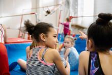 Girls Sitting On Floor In Gym Class
