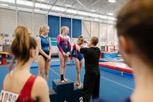 Three Girls On Podium In Gymna...