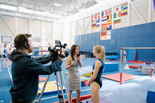 News Reporter Interviewing Gym...