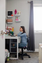 Girl Looking At Laptop At Desk