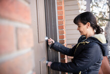 Woman Opening Front Door With Key