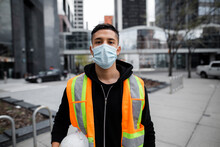 Portrait Confident Male Construction Worker In Face Mask In City