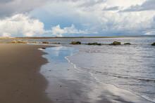 Ocean Wave On Sandy Beach With...