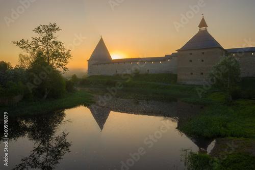 Fototapeta Misty sunrise at the Old Ladoga Fortress