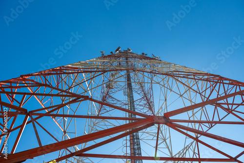 Valokuvatapetti Wireless communication antenna tower with blue sky