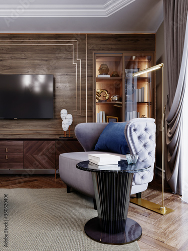 A luxurious armchair with quilted elements in violet blue, a black table nearby and an elegant gold floor lamp, in the living room against the background of a sideboard with decor and a TV unit Billede på lærred