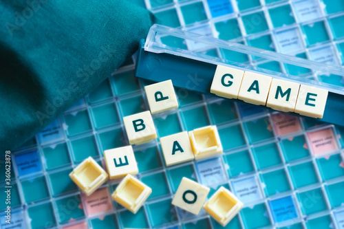 Inscription Game from letters. Concept of board games Wallpaper Mural
